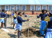 Many villagers and students from the local school helped to turn the soil of the school garden