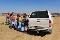 Women from the village wool cooperative try to catch the first look at the new arrival