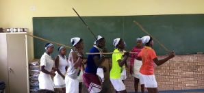 Local students share traditional song and dance